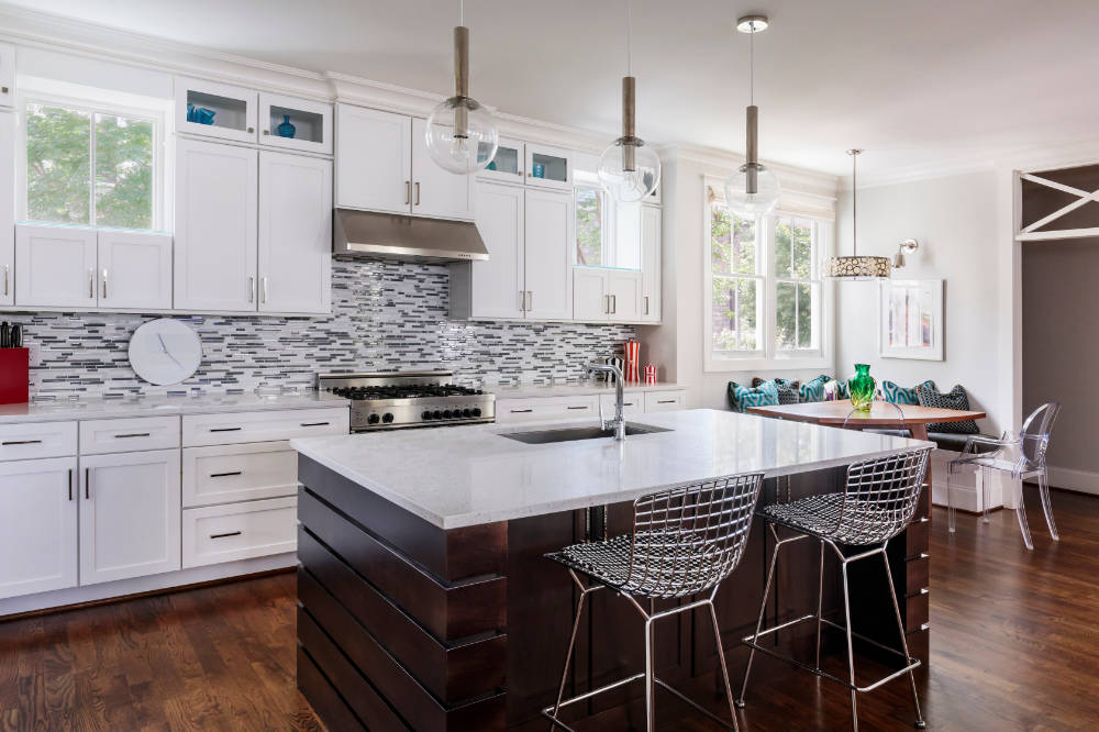 A photograph of an above normal sized kitchen with granite countertops possibly located in Raleigh North Carolina